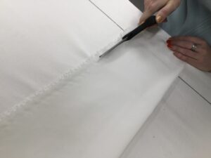 4. Trim raw edge to hemmed line